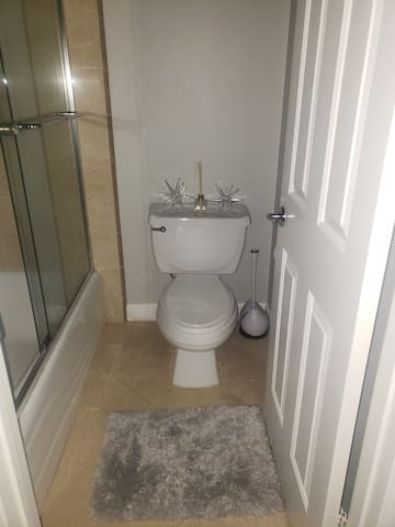Separate room in bathroom for toilet and shower.