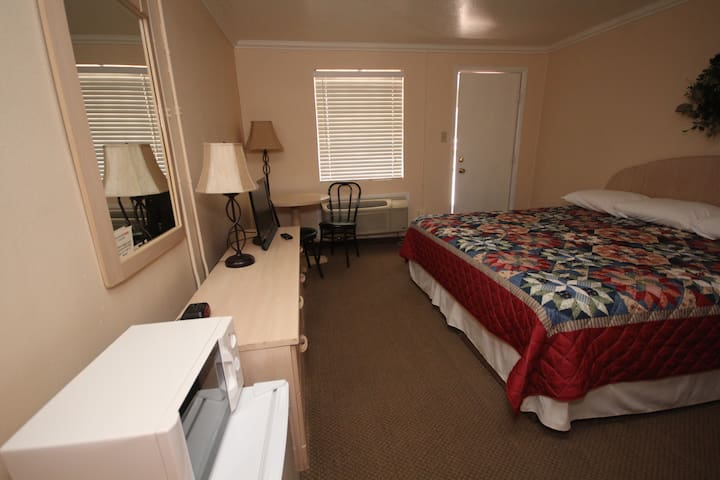 This is a room with a comfortable King size bed.