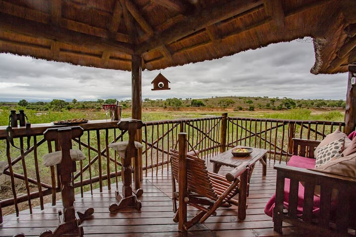 The large deck overlooking Crocodile River and Kruger Park. The best view in the whole park