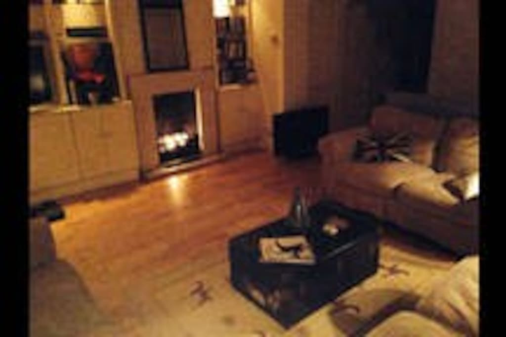 Large living room with fire place for those nasty rainy days