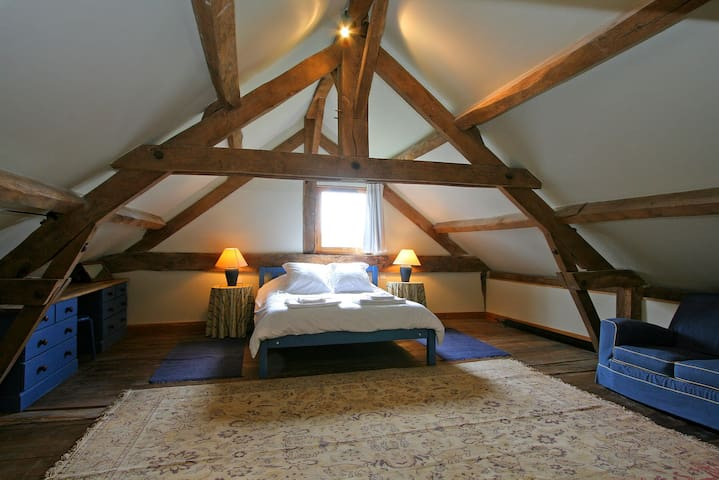 The bedroom which is on a mezzanine over the living space