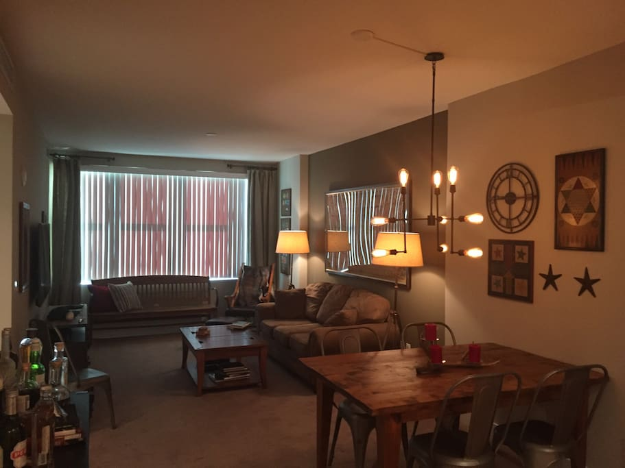 """Den and dining area. Cable, wifi, 60"""" HDTV,"""