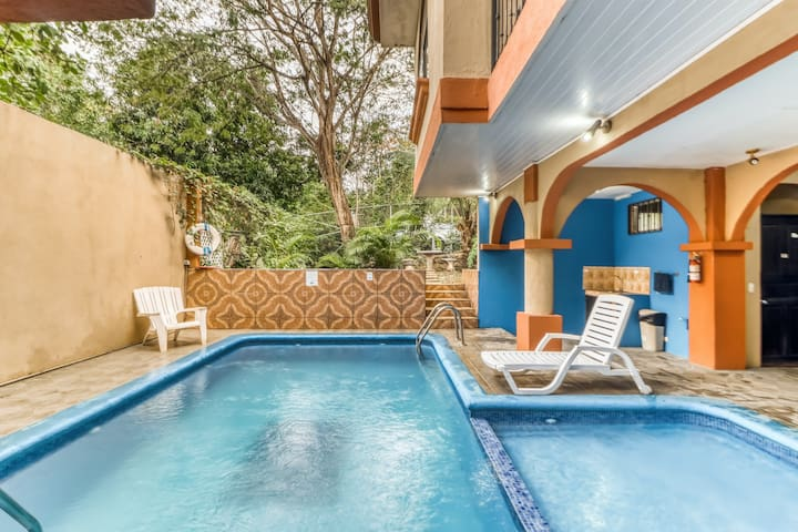 Comfy room w/great location, A/C, and shared outdoor pool! Walk to the beach!