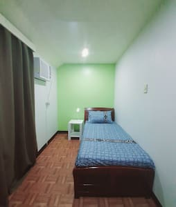 Clean and spacious room near the airport w/ Aircon