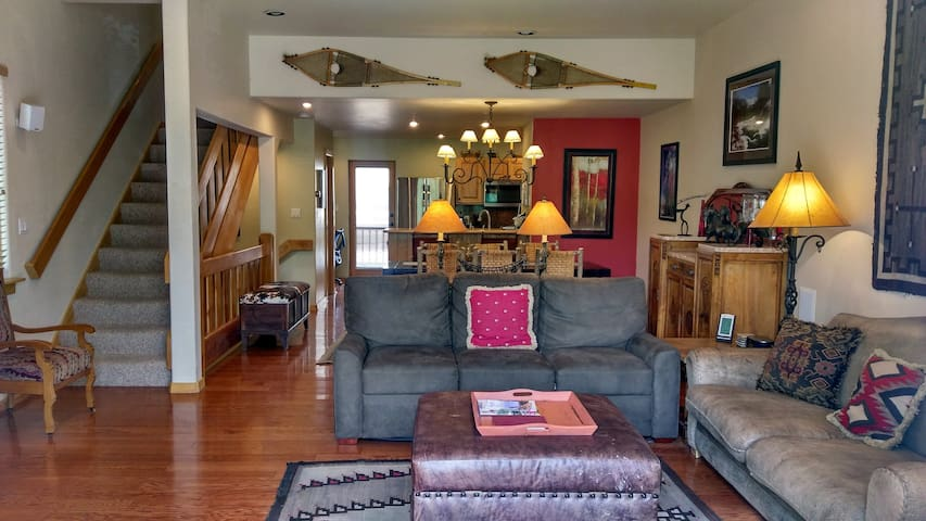 Living room with sofa bed, gas fireplace & dining table