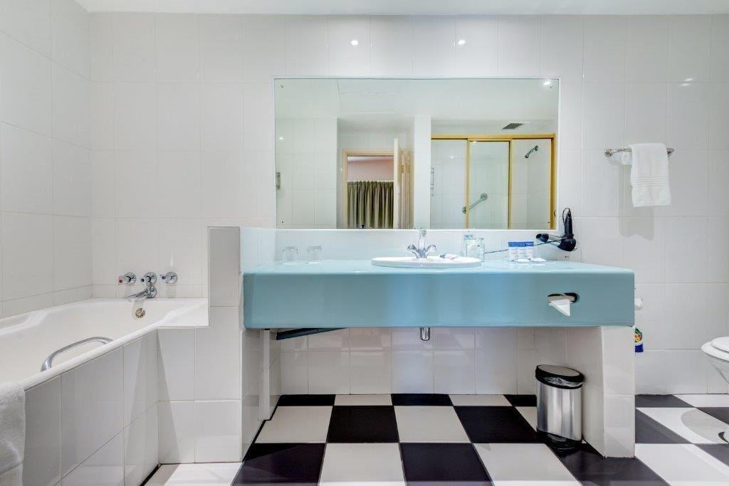 Big spacious bathroom with a shower and a bath.