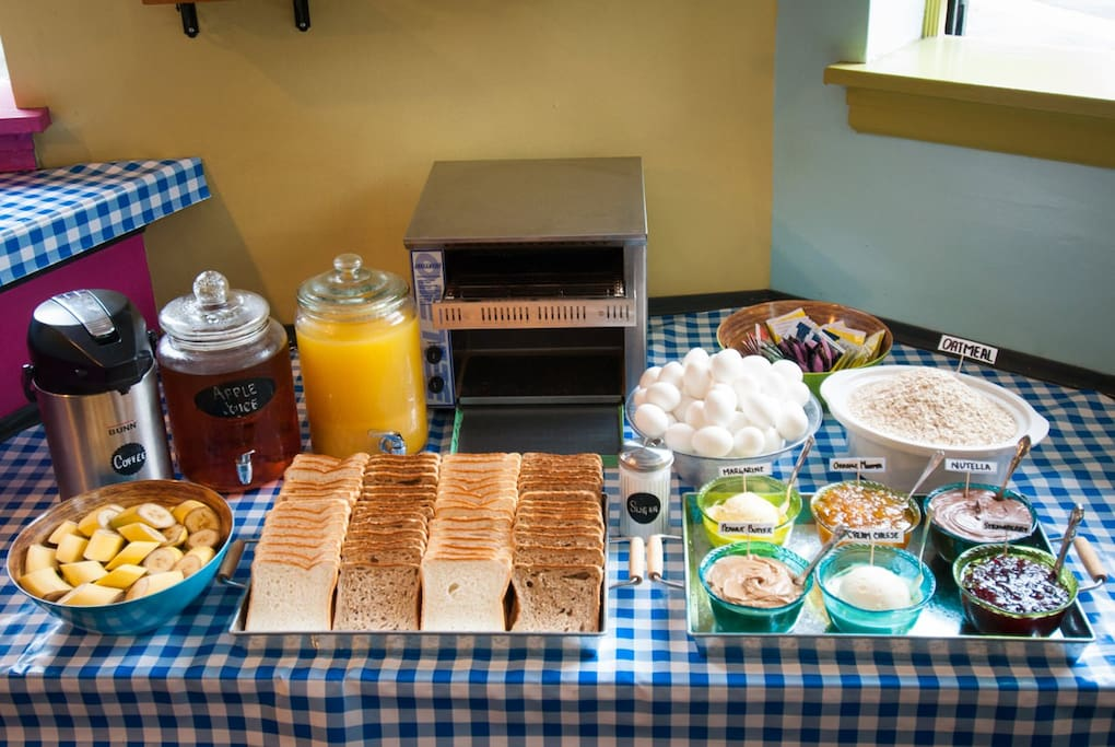 FREE BREAKFAST: We serve up a delicious continental breakfast every morning. Enjoy coffee, tea, juice, bananas, oatmeal, hard-boiled eggs, whole wheat, blueberry waffles, and a selection of spreads including peanut butter, jam, Nutella, cream cheese, & marmalade.