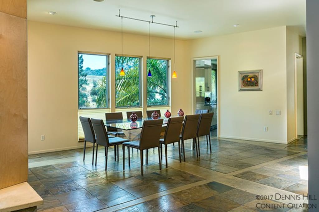Main living room + main dining room area. Kitchen entrance.