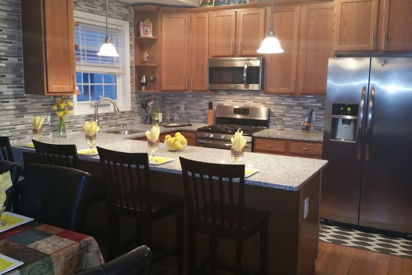 Kitchen with SS appliances, granite countertops and all kitchen amenities!