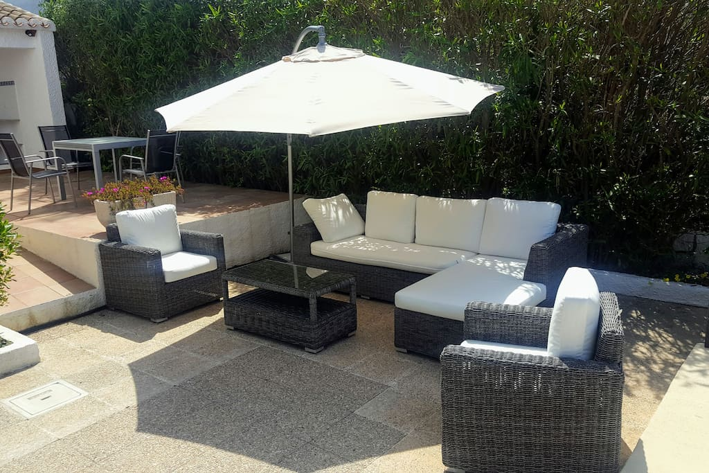 Take a comfortable seat next to the pool and BBQ area.