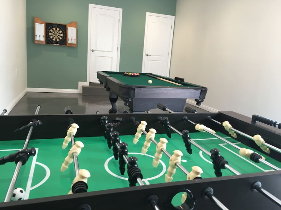 Game room with foosball, pool and darts. Shared with the upstairs airbnb rental.