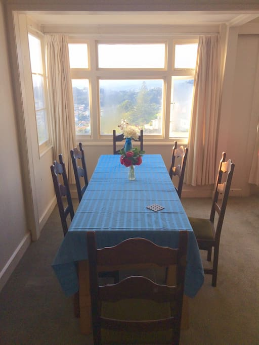 Dining table with windows overlooking the Eastern suburbs