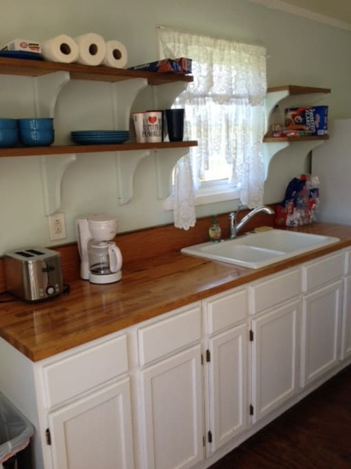 Complete kitchen with coffee maker and toaster, but no microwave.