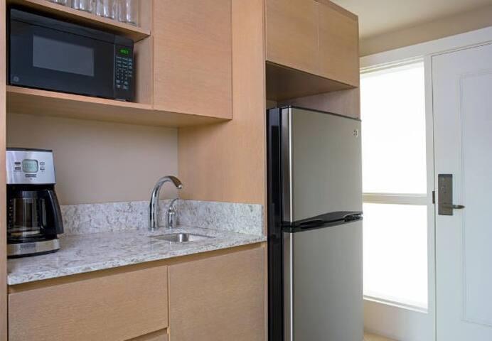 kitchenette full refrigerator