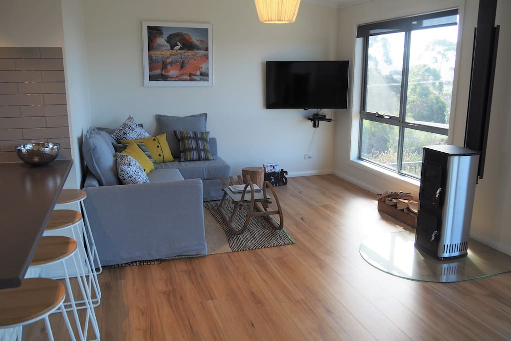 Comfortable living with wood fire and ocean views