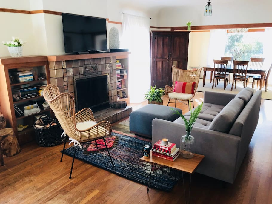 Family room with wood fireplace & entertainment center