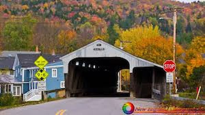 See the Blue Building sitting next to this famous Waitsfield Covered Bridge!?