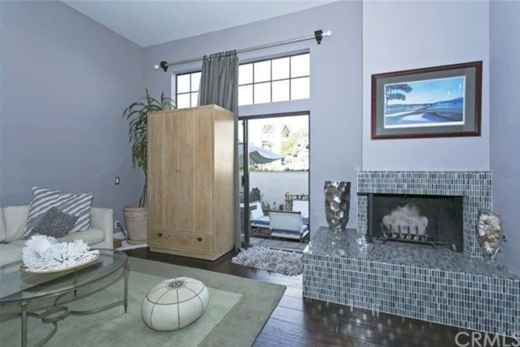 Lovely living room with television in cabinet.  Goes out to outdoor patio and gas barbecue.