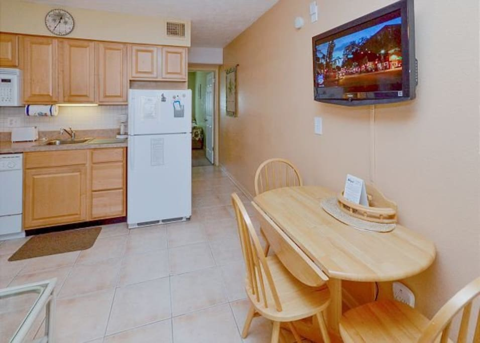 Kitchen & eating area with flat screen TV