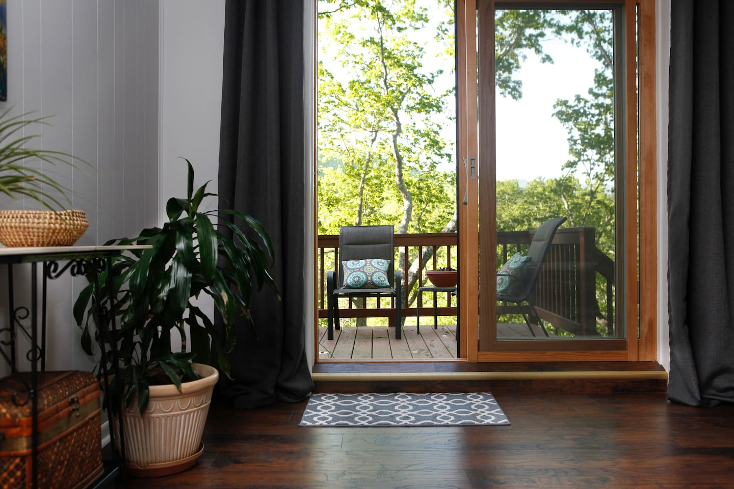 Your private deck with mountain and river views is just outside the living room (here) and also the kitchen door