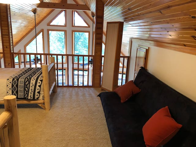 Loft room. Has folding screen for privacy.