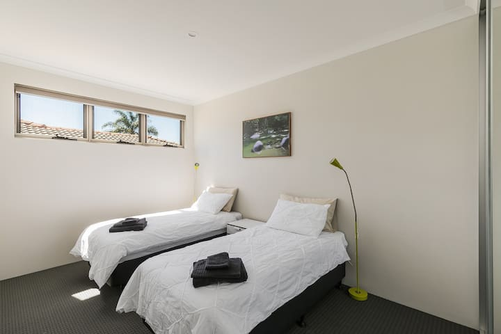 2 X single beds with bedside lamps. Complimentary towels
