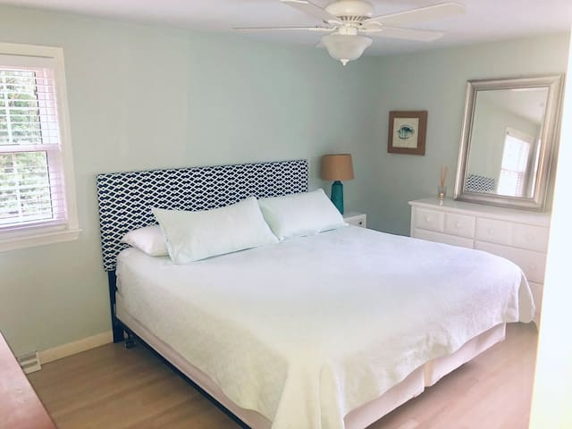 Master Bedroom with overhead fan and attached full bath