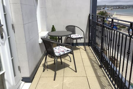 Beach front apartment with balcony