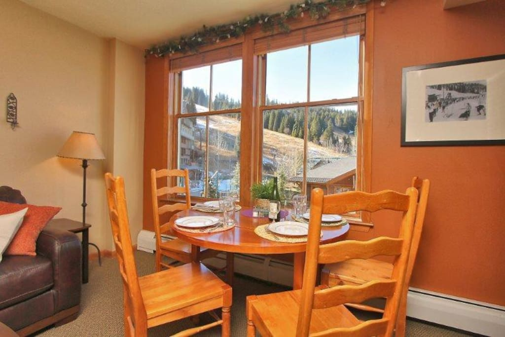 Look out at the slopes while you dine and this comfy table for four