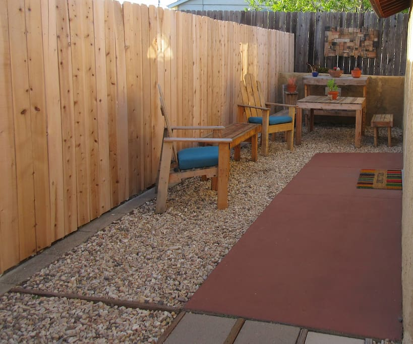 Cozy outdoor seating area with picnic table.  Enjoy a cool drink or a meal here after a day at one of the local beaches.