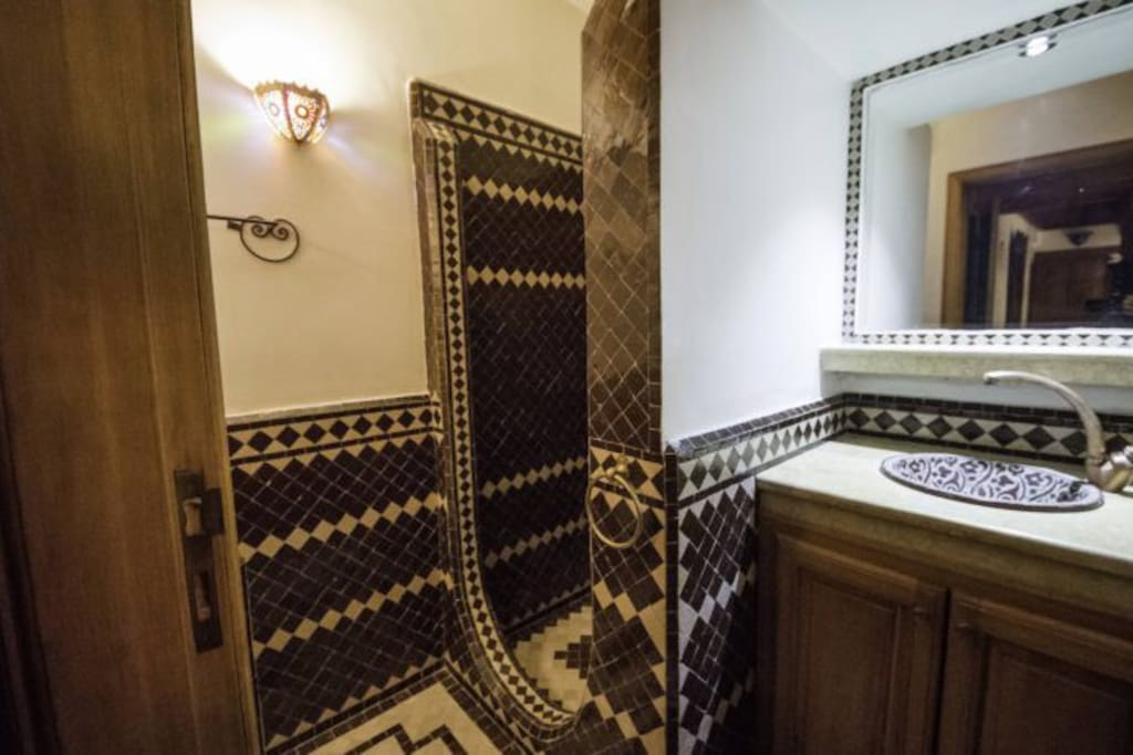 Beautiful bathroom all floors and walls hand made mosaic local tiles and marble matching the room colors of Atlas mountain.