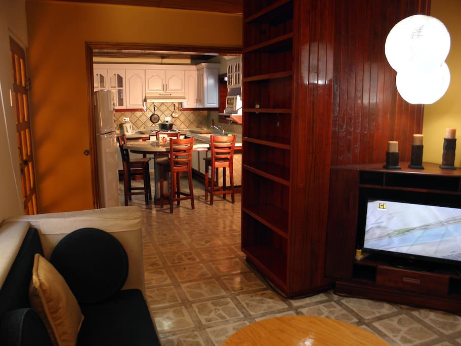 TV room and kitchen.