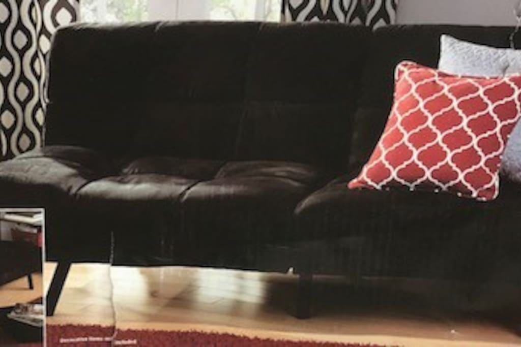 Sofa/Bed for washing TV or lounging.