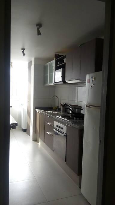 Cocina y zona de lavado