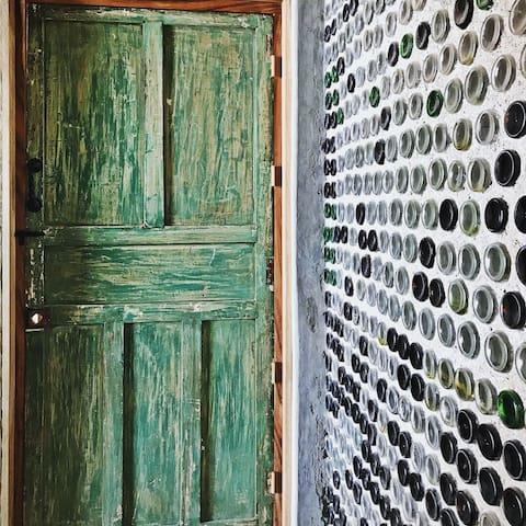 Repurposed antique doors on the bathroom.