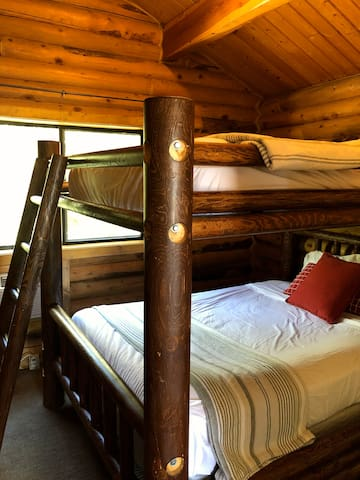 Back bedroom queen over queen bunk bed.