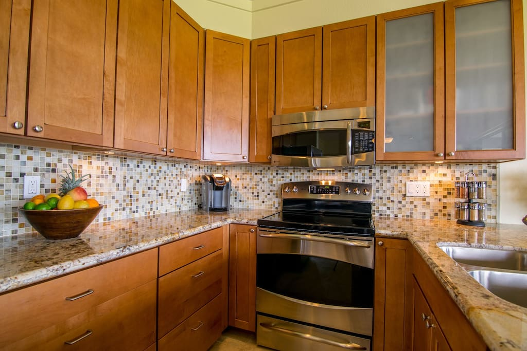 Custom cabinets, tile work and stainless steel appliances
