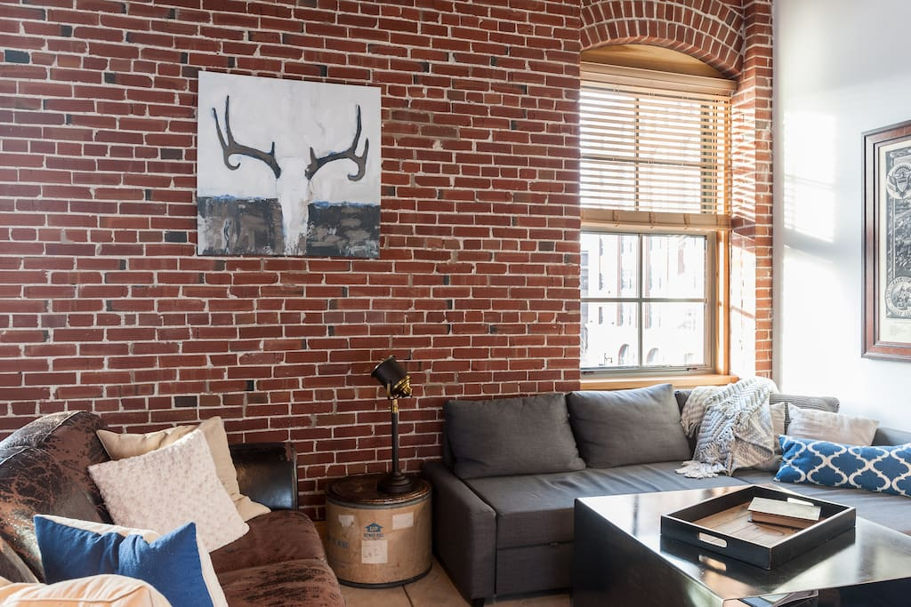 The high ceilings and exposed bricks make for a beautiful space.