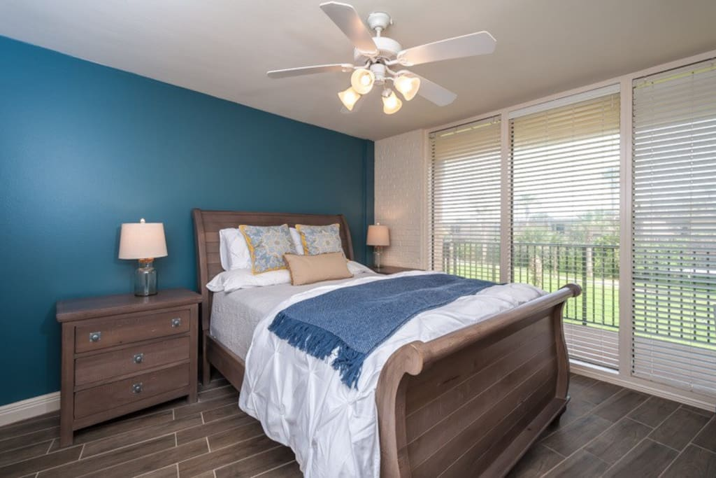 The master bedroom with a queen bed.