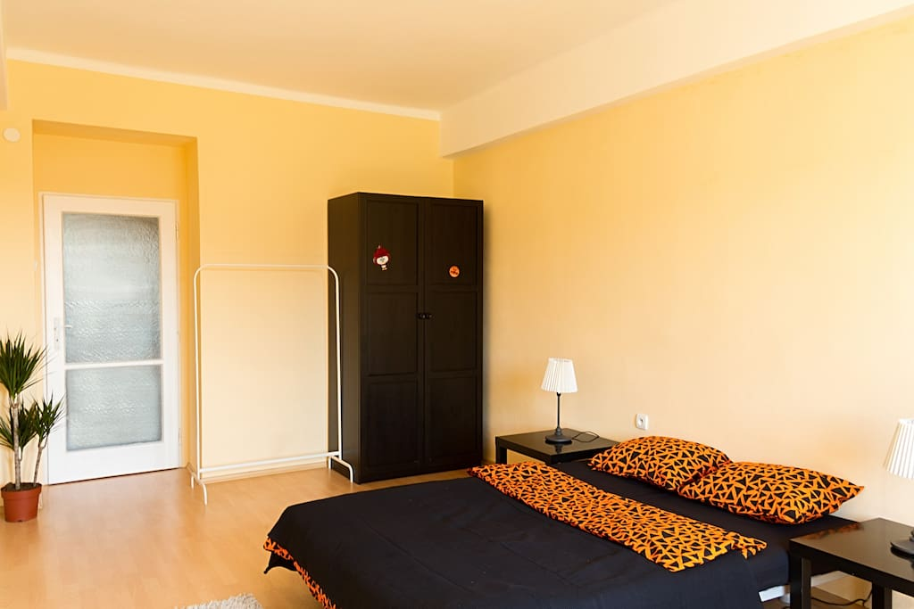 This bedroom has all you need for your comfortable stay in Prague: Comfy bed with soft pillows, wardrobe,  work-table and comfy armchair