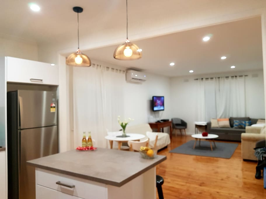 Enjoy the gorgeous open plan living area..the tv can be swiveled toward the kitchen area if desired♥ all lights have separate switches so can be bright or subtle as suited♥ ac & heating also there but please keep to a minimum for the environment