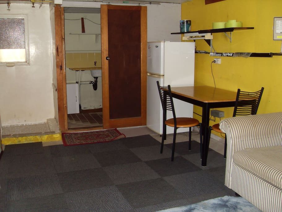 on the left is bedsit shower and over door way is the kitchen sink and separate loo room is around the corner.