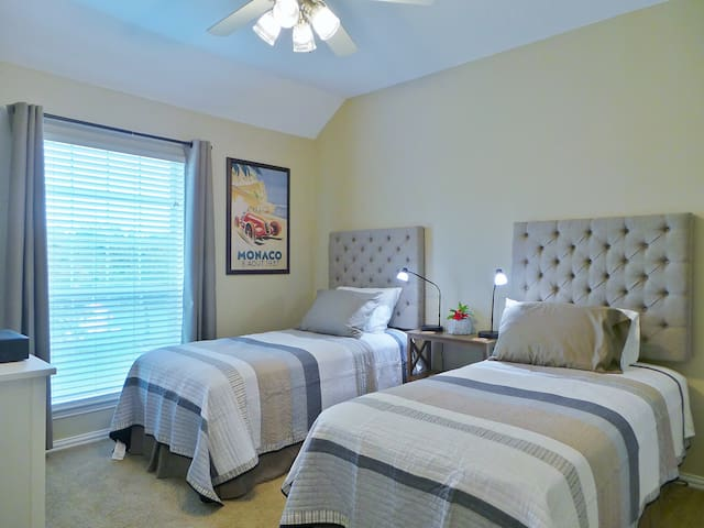 Both upstairs bedrooms have two twin beds in each of them!