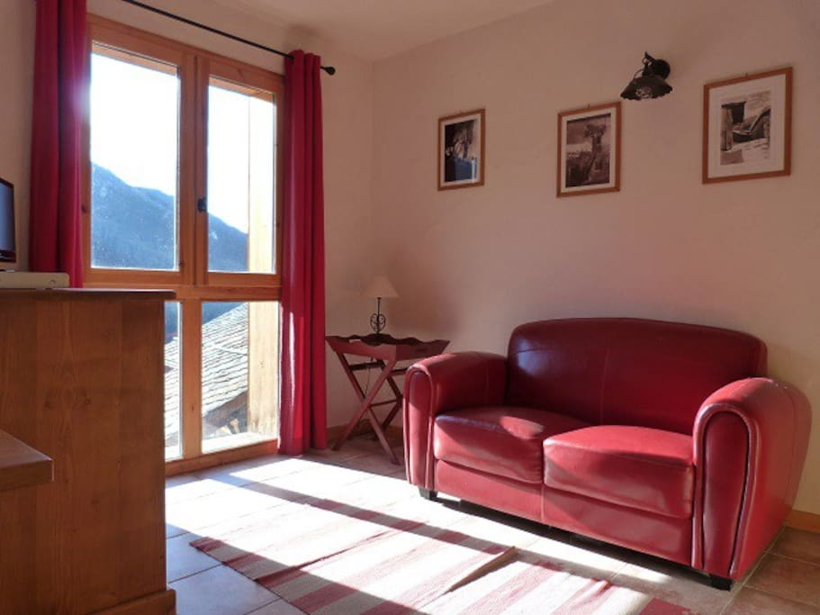 The lounge area has stunning views, red leather sofa and TV/DVD
