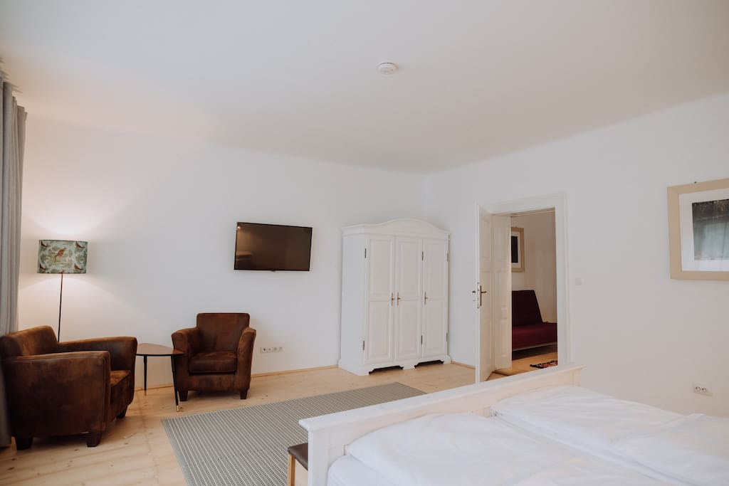 Large bedroom with reading area