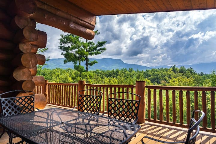 Breathtaking mountain views and private forest scenes in amazing large log cabin