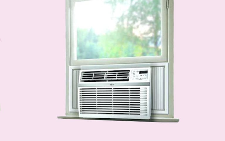 Powerful Window AC Unit in the room to keep you cool during summer.