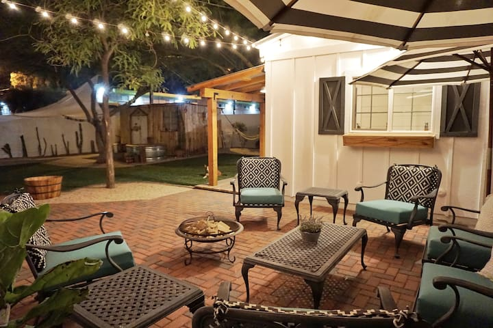 Private patio with lots of outdoor seating and picture perfect string lighting.