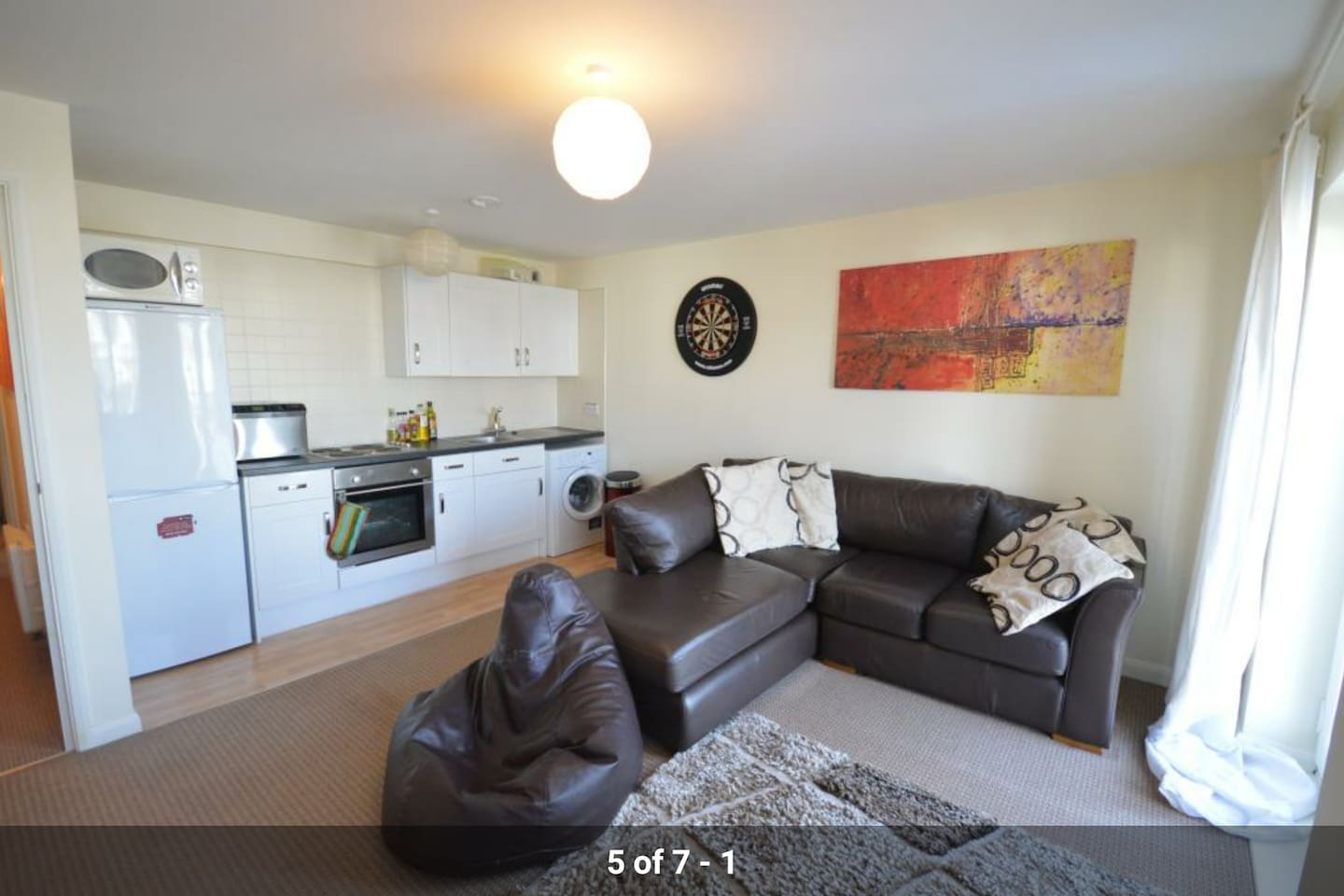 Lounge and Kitchen. Includes fridge, freezer, washing machine and oven. Sadly the dart board is no longer there!