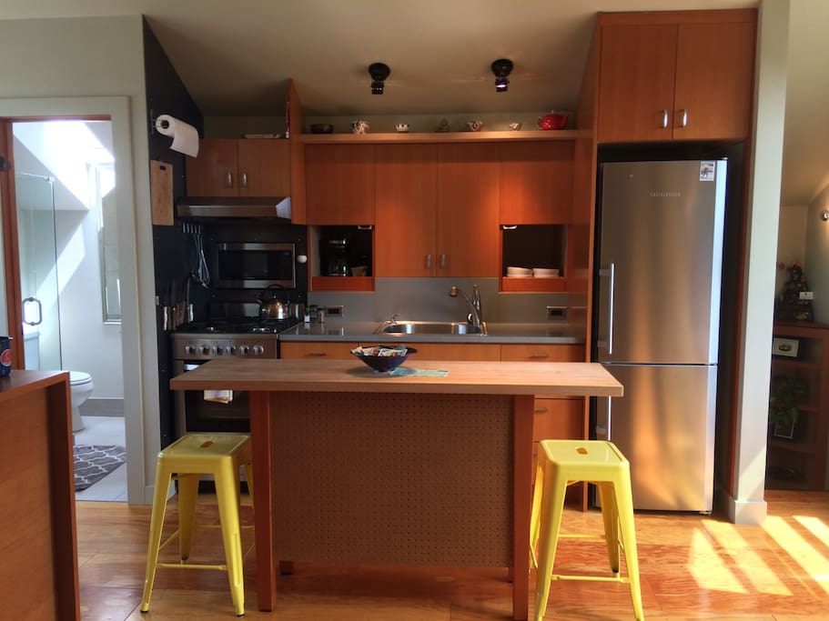 Kitchen island with 2 stools.